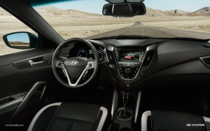 Veloster's interior looks great, with an efficient steering wheel hub full of buttons and a good video screan mid-dash.