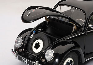 Under the hood, simply a spare tire. Hinges are well executed to hold the hood up for display.