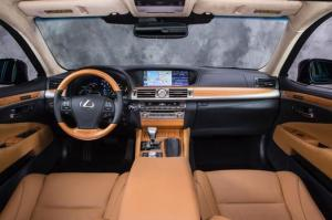 No denying the LS's interior is gorgeous, with wood trim and leather seat, plus a wood/leather steering wheel