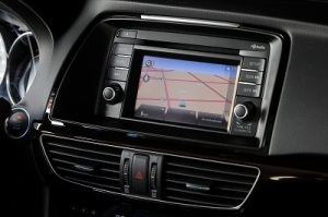 The navigation and radio screen is small with tiny on screen buttons and little volume and tuning knobs.