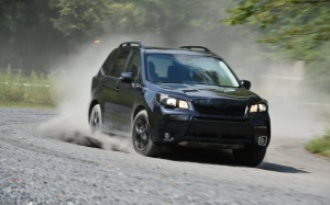 A black pre-production Forester reflects its Darth Vader looks.