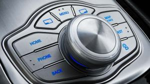 The dreaded knob to select a miriad functions is cumbersome to use while driving.
