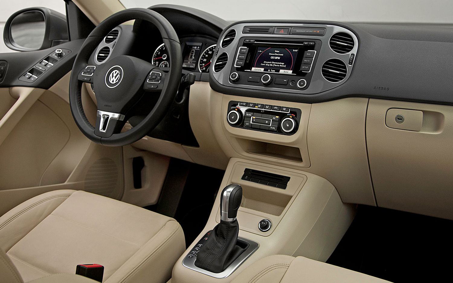 As expected tiguan s rear seats split and fold down to boost cargo space there s 24 cubic feet of space under the hatch about 10 cubic feet less than the