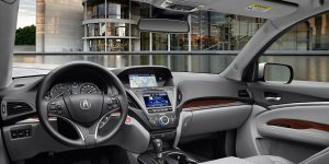 The MDX has plenty of electronic gadgets, including a rearview camera and blind-spot warning system, plus adaptive cruise control.