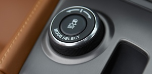 You can dial in your driving mode with this dial on the console.