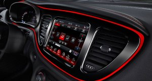 Dodge spiffs up the interior with the red trim line ringing the dash controls.
