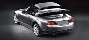 The power hardtop folds down easily and quickly as seen here on a silver Miata.