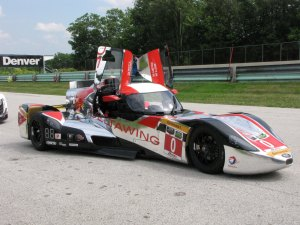 For 2014 the DeltaWing became a coupe with an enclosed cockpit. This is in the pits at Road America.