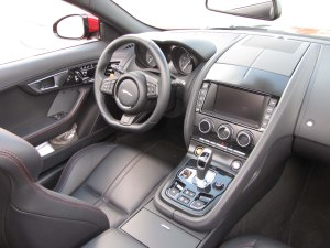 Love the interior layout and execution, plus the flat-bottomed steering wheel.