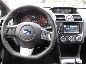 Good gauges and love the flat-bottomed steering wheel here.
