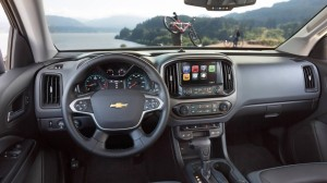Chevy delivers a macho dash with big buttons, knobs and a big touch screen.