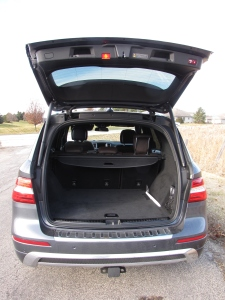 Roomy describes the cargo area, and the hatch is powered.