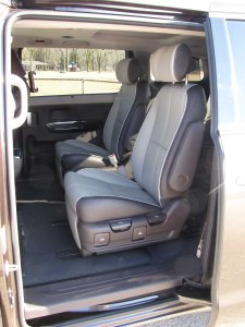 Side doors slide wide open for easy access to the second and third-row seats, an attractive two-tone in the test van.