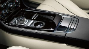 The shifter is a metal knob that rises from the console on the Jag.