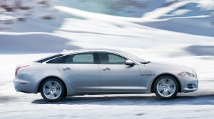 Even in snow this Jag handles like a sports sedan.