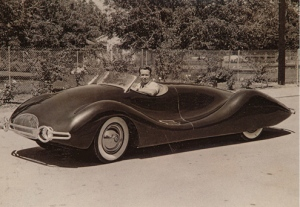 Norman Timbs in the original Streamliner he built in 1948. It's powered by a Buick straight-8 engine.