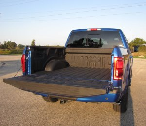Oh, that's right, a pickup is for hauling! The tail is easy drop, just unlatch and it easily lowers with no clunk or bang!